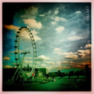 Over the River Thames, the London Eye looms large